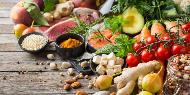 Assortment of healthy food ingredients for a Flexitarian diet on a wooden kitchen table